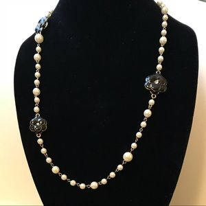 Gold and pearl necklace with black flowers